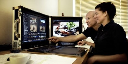 "Sabine Kämper and Detlef Overmann choosing photos for ""Chorus and Cuisine – Namibia"""