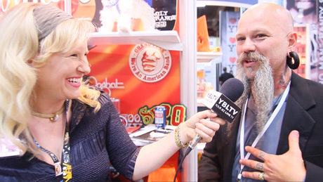 R-Evolution Founder & Creator, Jeremy Schulz with YBLTV Anchor, Erika Blackwell at Licensing Expo 2013 (Your Biz LIVE Photo/R-Evolution)