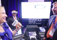 Evena Medical CEO Frank J. Ball and CFO, David Gruebele demonstrate Evena's Eyes On to YBLTV Anchor Erika Blackwell at International CES 2014 (Image Courtesy: Your Biz LIVE/Evena Medical).