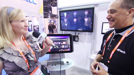 DFI Tech's Business Development Manager, Jaime Garcia chats demos the company's MK20 to YBLTV Anchor, Erika Blackwell at Digital Signage Expo 2014. (Image Courtesy: DFI Tech/Your Biz LIVE).