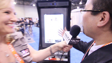 Lo-K Systems, Inc. VP of Development, Michael Burdeos chats with YBLTV Anchor, Erika Blackwell at Digital Signage Expo 2014 (Image Courtesy: Lo-K Systems, Inc./Your Biz LIVE).