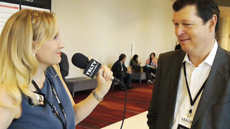 Chris DeMoulin, Executive Vice President, Customer Development & President, Licensing, Advanstar Communications, Inc. speaks with YBLTV Anchor, Erika Blackwell at MAGIC 2014. (Image Courtesy: MAGIC/Your Biz LIVE).