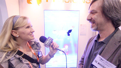 T1Visions CEO, Mike Feldman demos the company's QVue™ Waitlist App to YBLTV Anchor, Erika Blackwell at Digital Signage Expo 2014 (Image Courtesy: T1Visions/Your Biz LIVE).