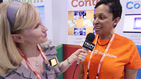 Wovenmedia Co-Founder & CEO Susie Opare-Abetia talks with YBLTV Anchor Erika Blackwell at Digital Signage Expo 2014. (Image Courtesy: Wovenmedia/Your Biz LIVE).