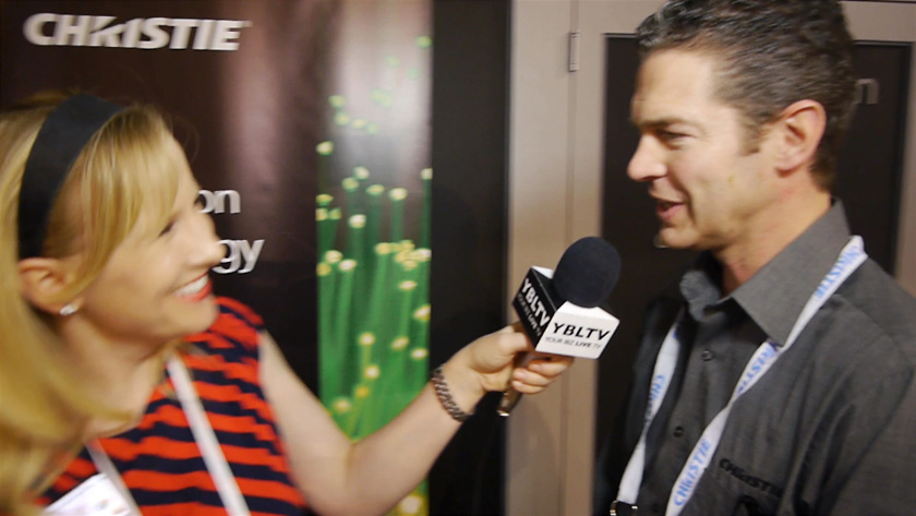 Christie Director of Marketing, Steve Capling chats with YBLTV Anchor, Erika Blackwell at NAB 2014 on the Future of Projection Technology (Image Courtesy: Christie/Your Biz LIVE).