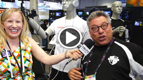 MXL Mics Director of Sales & Marketing, Perry Goldstein demos the company's Mobile Media Mannequins to YBLTV Anchor, Erika Blackwell at NAB 2014. (Image Courtesy: MXL Mics/Your Biz LIVE).