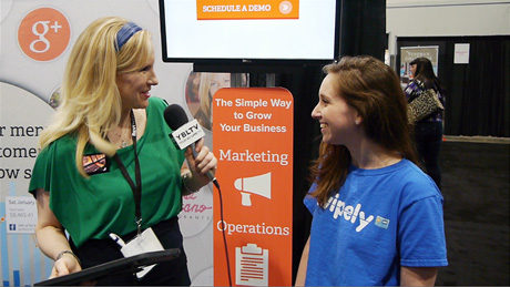 Swipley Senior Manager, Public Relations & Marketing Elizabeth Sigal Ducoff chats with YBLTV Anchor Erika Blackwell at Nightclub & Bar Show 2014. (Image Courtesy: Swipely/Your Biz LIVE).