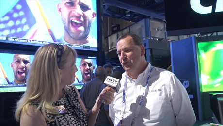 Christie's Manager, Marketing Programs, Douglas Grant talks Christie Roadie 4K with YBLTV Anchor, Erika Blackwell at InfoComm 2014. (Image Courtesy: Christie Digital Systems USA, Inc. / Your Biz LIVE).