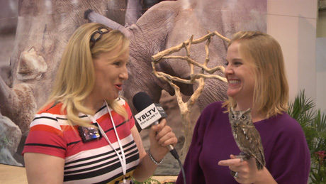 SeaWorld's Bonzai and Zoological Operations Animal Ambassador Team member, Angie Llanas chat with YBLTV Anchor, Erika Blackwell at Licensing Expo 2014. (Image Courtesy: SeaWorld / Your Biz LIVE).