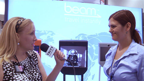 Suitable Technologies, Inc., Director of Marketing, Erin Rapacki talks with YBLTV Anchor, Erika Blackwell at InfoComm 2014. (Image Courtesy: Suitable Technologies, Inc. / Your Biz LIVE).