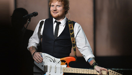 Ed Sheeran performs on stage at the 57th Annual Grammy Awards in Los Angeles February 8, 2015. (Photo credit: ROBYN BECK/AFP/Getty Images)