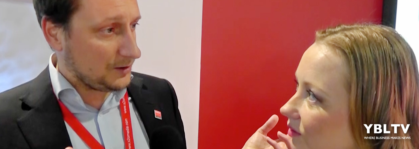 Bas Van Heek, Strategic Marketing Manager, Retail and Advertising, Barco, chats with YBLTV Anchor, Dawn Church at the 2016 Digital Signage Expo.