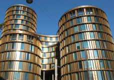 Axel Towers, adorned with 240 tons of brass sheets, is a new focal point of the Copenhagen skyline.