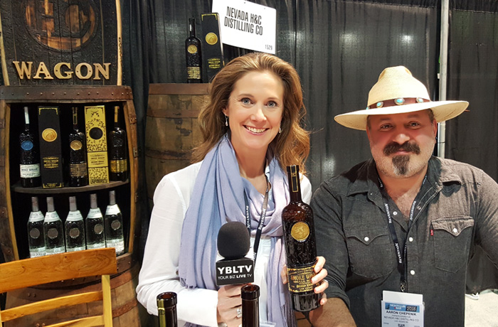 YBLTV Anchor & Writer / Reviewer, Brandy Falconer with Nevada H&C Distilling's Aaron Chepenik at the2018 Nightclub & Bar Show in Las Vegas, Nevada.