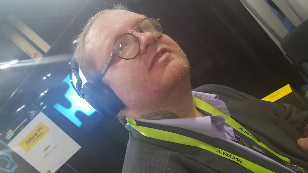 YBLTV Writer / Reviewer / Anchor, Jack X wearing Jabra Elite 85h Headphones.